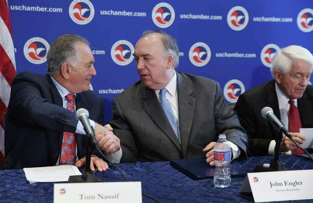 WASHINGTON, DC - JULY 09: Western Growers President and CEO Tom Nassif (L) shakes hands with Business Roundtable President and former Michigan Gov. John Engler after a news conference with U.S. Chamber of Commerce President and CEO Thomas Donohue (R) as part of a 'Day of Action for Immigration Reform' at the U.S. Chamber of Commerce July 9, 2014 in Washington, DC. According to a Partnership for a New American Economy survey supported by the business leaders, 86-percent of those polled want Congress to undertake immigration reform and 70-percent said they would vote for a presidential candidate from a party that is viewed as supporting immigration reform. (Photo by Chip Somodevilla/Getty Images)