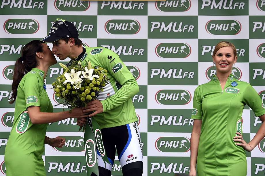 What am I, chopped liver?Slovakia's Peter Sagan kisses one hostess while seemingly ignoring the other as he celebrates his green jersey following the sixth stage of the Tour de France between Arras and Reims. Photo: Eric Feferberg, AFP/Getty Images
