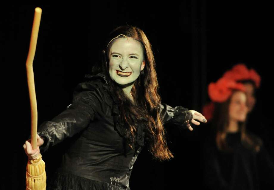 "The Wicked Witch of the West finds reason to smile during a dress rehearsal for ""The Wizard of Oz"" at Bethel High School. The beloved musical was performed there this past spring, directed by Crystal Schew and starring Kathryn Kennedy as Dorothy. Photo: Tyler Sizemore / The News-Times"