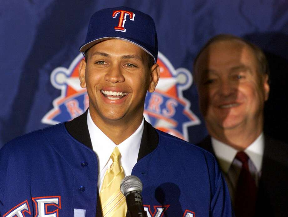 "2001: ""A-Rod"" strikes it richThe Texas Rangers' signing of former Seattle Mariners shortstop Alex Rodriguez was more notable for its impact on he ledger than on the field. Rodriguez's 10-year, $252 million deal was $63 million higher than any other Major League contract to that point. The Rangers averaged just 72 wins per season with the 2003 American League MVP, eventually shipping him -- and his contract -- to the New York Yankees in 2004. Photo: DONNA MCWILLIAM, ASSOCIATED PRESS / AP2000"