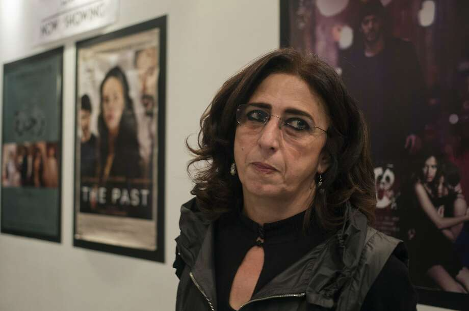 Marianne Khoury, the niece of Egypt's most lauded movie director, visits the Zawya cinema in Cairo. Photo: Khalil Hamra, Associated Press