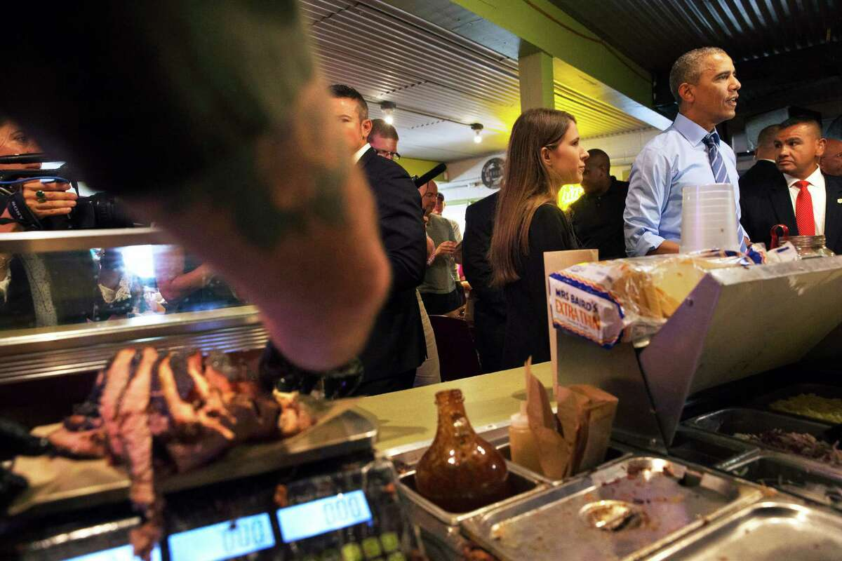Brisket is cut at left as President Barack Obama orders barbecue at Franklin Barbecue in Austin, Texas, Thursday, July 10, 2014. Austin is the final leg in his three city trip before returning to Washington. (AP Photo/Jacquelyn Martin)
