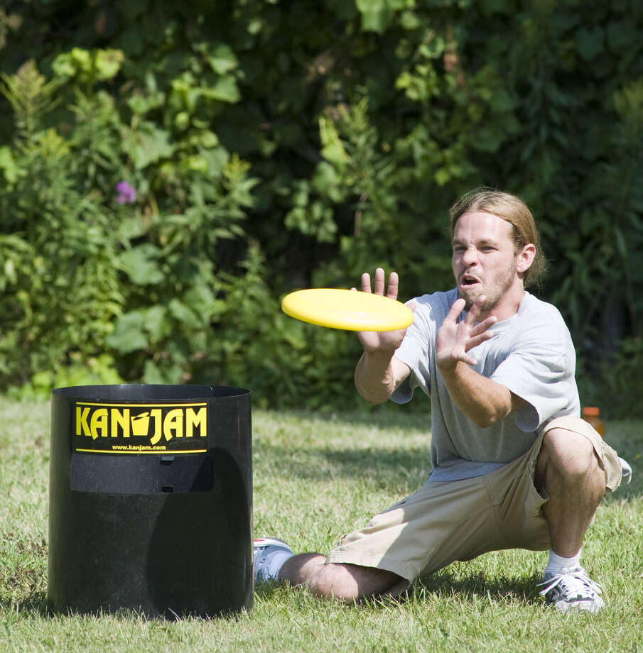 To an uninformed viewer, KanJam is simply a game of tossing a flying disc back and forth into a garbage can. Which is pretty much the origin of the game. Charles Sciandra, the cofounder of KanJam LLC, conceived the game a couple decades ago when he and some buddies were playing with a flying disc, trying to get it into metal garbage cans that had seen better days. What started as a casual game a group of guys would play at the beach or in a backyard quickly became something Sciandra saw worth attempting to market. And in the Capital Region it's been the centerpiece of cookouts, graduation parties and family reunions. (Courtesy KanJam)