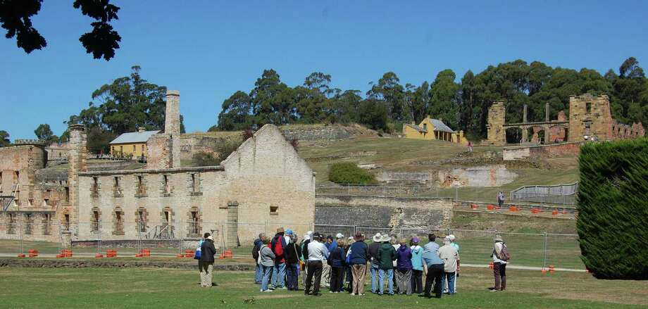 A tour group prepares to visit what remains of the high-security prison at Port Arthur on the Australian island of Tasmania. Photo: Photos By Bob McCullough / For The Express-News