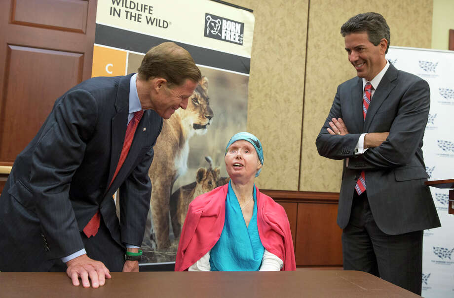 Sen. Richard Blumenthal, D-Conn., left, and Wayne Pacelle, president and CEO of the Human Society of the United States, right, talk with Charla Nash during a news conference on Capitol Hill in Washington, Thursday, July 10, 2014. Nash was mauled by a pet chimp and had to undergo a face transplant. She is now advocating for a bill to be passed that would ban the interstate trade of primates as pets. Photo: AP Photo/ Evan Vucci / Associated Press