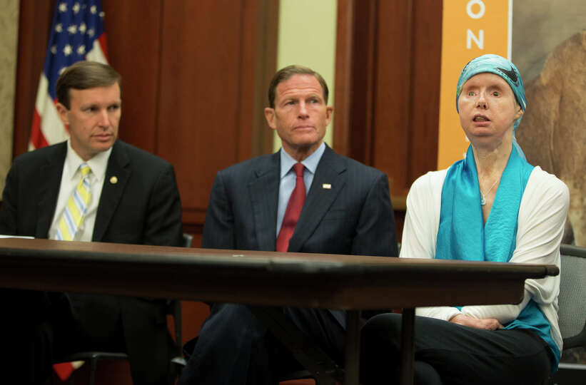 Sen. Christopher Murphy, D-Conn., left, and Sen. Richard Blumenthal, D-Conn., center, sit with Charl