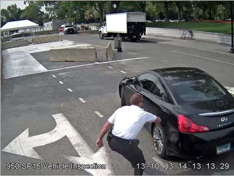 Still photo of video footage at the White House checkpoint on Oct. 3, 2013 as Miriam Carey drove up and officers tried to block her vehicle using a bike rack. Photo: Contributed Photo / Stamford Advocate Contributed