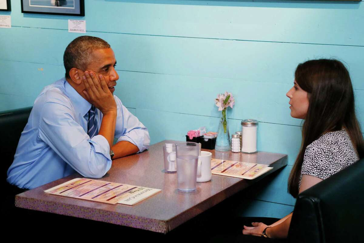 President Barack Obama meets with Kinsey Button at Magnolia Cafe in Austin on Thursday, July 10, 2014.
