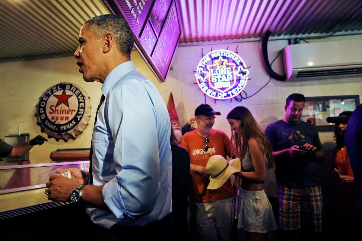 President Barack Obama orders barbecue at Franklin Barbecue in Austin, Texas, Thursday, July 10, 2014. Austin is the final leg in his three city trip before returning to Washington. (AP Photo/Jacquelyn Martin)