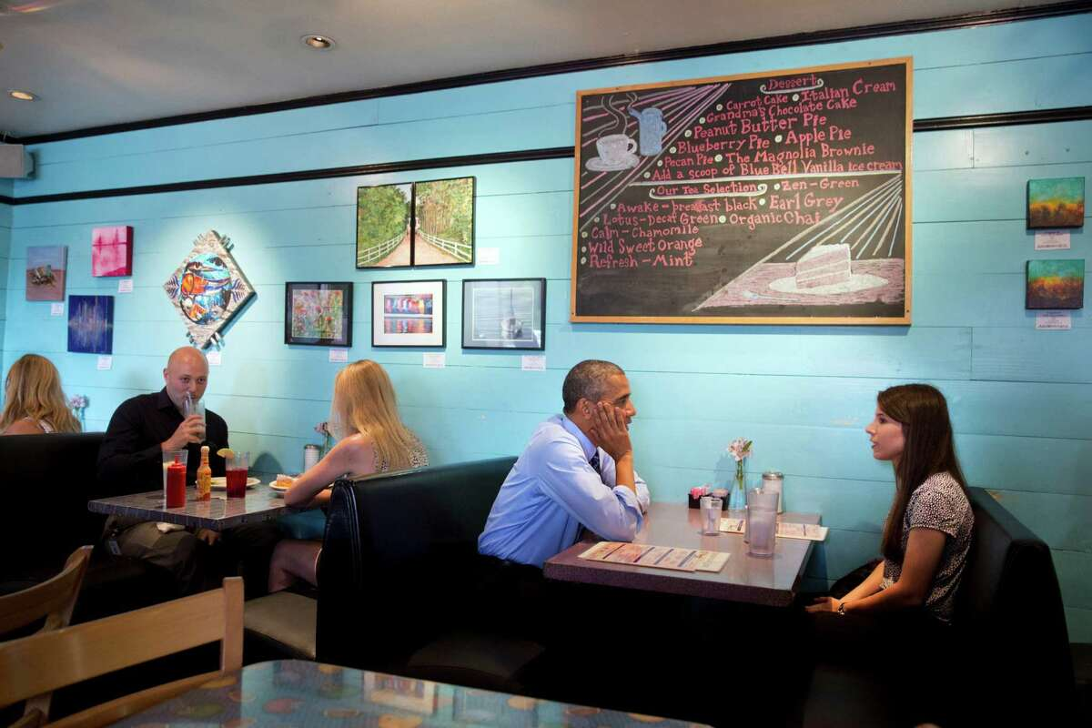 President Barack Obama meets with Kinsey Button at the Magnolia Cafe in Austin on Thursday, July 10, 2014. Button, a student at the University of Texas at Austin, wrote the president a letter in January explaining her family's struggle to lead a middle class life when both of her parents lost their jobs in the wake of the Great Recession.