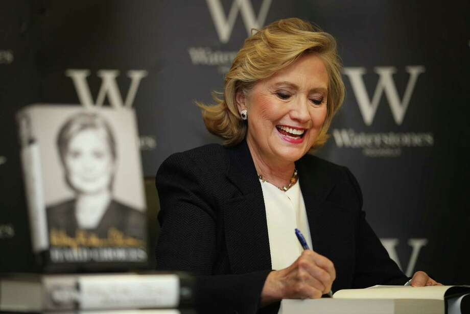"Former U.S. Secretary of State Hillary Rodham Clinton signs copies of her  book in London. Clinton has taken heat for saying she and former President Bill Clinton were ""dead broke."" But a reader says there is a difference between being poor and being broke. Photo: Peter Macdiarmid / Getty Images / 2014 Getty Images"
