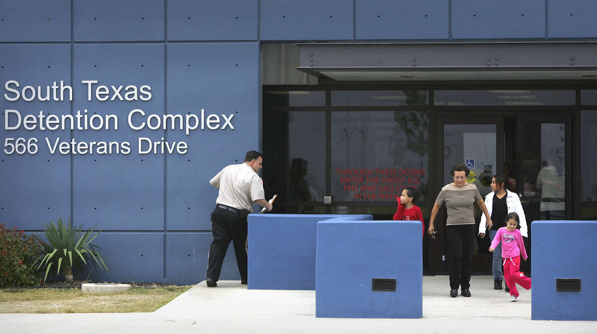 FILE - A woman and her grandchildren leave the South Texas Detention Complex in Pearsall in 2008. Immigration and Customs Enforcement operates the facility.