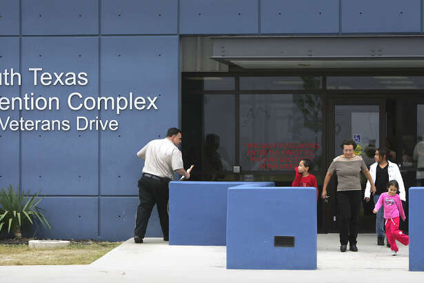A woman and her grandchildren leave the South Texas Detention Complex in Pearsall, where the kids' father was held, in 2008. Immigration and Customs Enforcement operates the facility.