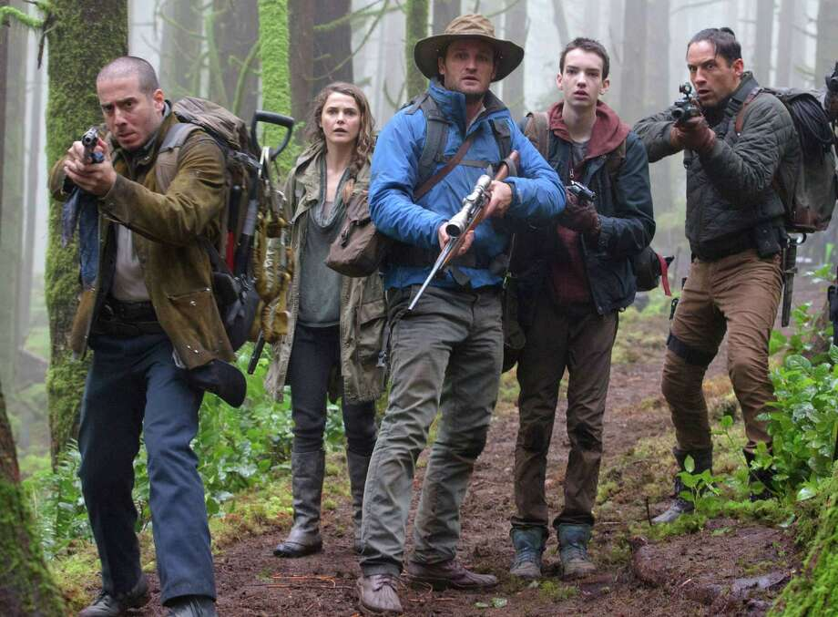 """This photo released by Twentieth Century Fox Film Corporation shows from left, Kirk Acevedo, Keri Russell, Jason Clarke, Kodi Smit-McPhee and Enrique Murciano in a scene from the film, """"Dawn of the Planet of the Apes."""" (AP Photo/Twentieth Century Fox Film Corporation, David James) ORG XMIT: NYET133 Photo: David James / Twentieth Century Fox Film Corpo"""