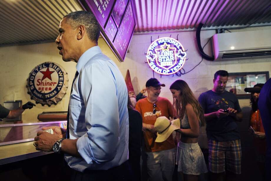 President Barack Obama orders barbecue at Franklin Barbecue in Austin, Texas, Thursday, July 10, 2014. Austin is the final leg in his three city trip before returning to Washington. (AP Photo/Jacquelyn Martin) Photo: Associated Press