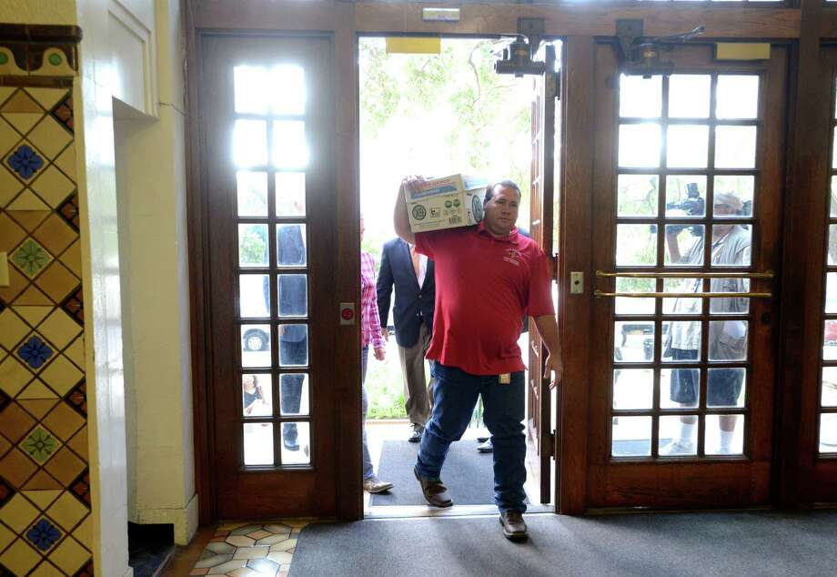 Stephen Moody carries a box containing signatures on petitions to the city clerk's office on Tuesday morning, July 8, 2014. Photo: San Antonio Express-News / San Antonio Express-News