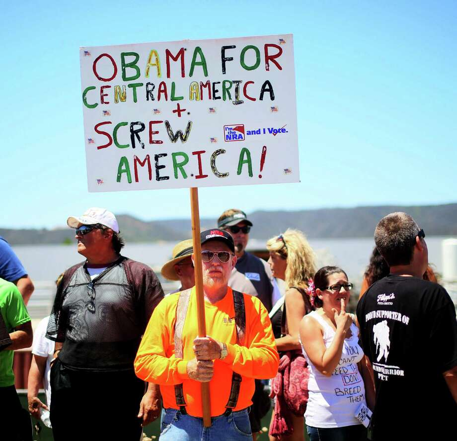 Anti-immigration activists protest outside of the U.S. Border Patrol Murrieta Station in Murrieta, Calif.  Their actions confronting children and their mothers were shameful. Photo: Sandy Huffaker / Getty Images / 2014 Getty Images