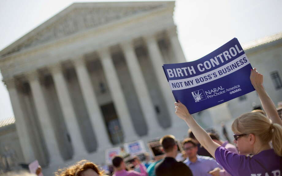 FILE - This June 30, 2014 file photo shows a demonstrator holding up a sign outside the Supreme Court in Washington on the day the court decided in the Hobby Lobby case to relieve businesses with religious objections of their obligation to pay for women's contraceptives among a range of preventive services the new health law calls for in their health plans. How much distance from an immoral act is enough is the difficult question behind the next legal dispute over religion, birth control and the new health law that is likely to be resolved by the Supreme Court. The issue in more than four dozen lawsuits from faith-affiliated charities, colleges and hospitals who oppose some or all contraception as immoral is how far the Obama administration must go to accommodate them.  (AP Photo/Pablo Martinez Monsivais, File) ORG XMIT: WX401 Photo: Pablo Martinez Monsivais / AP