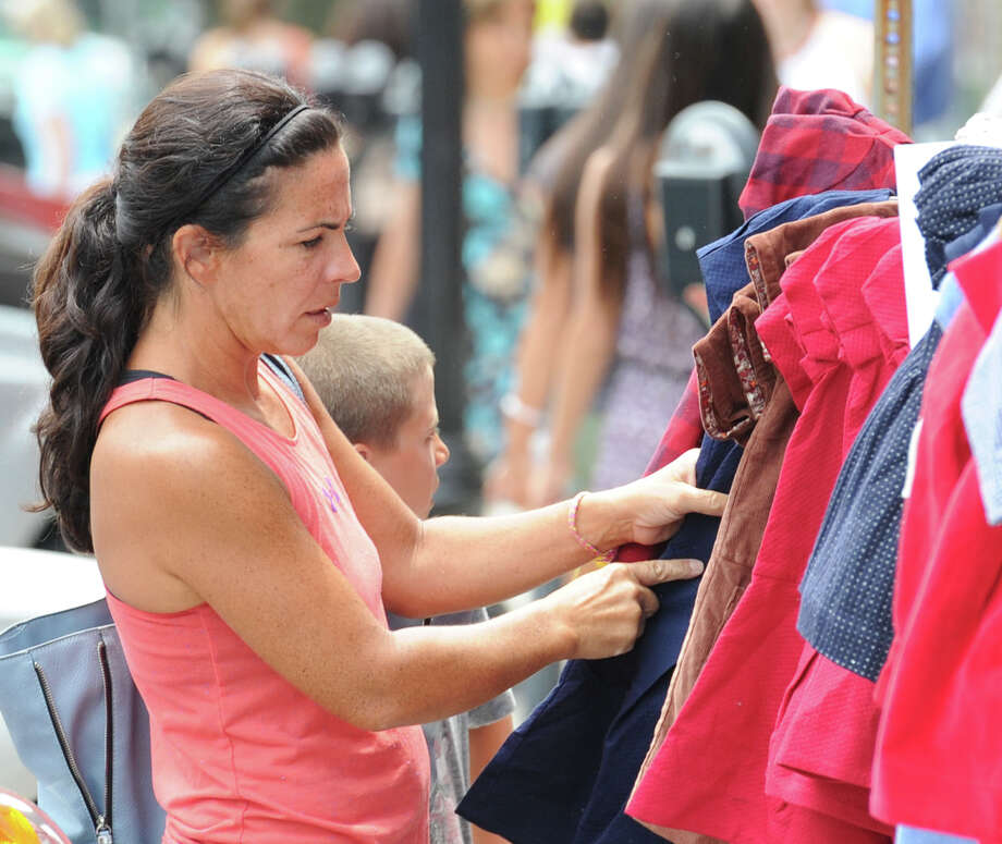 The Greenwich Sidewalk Sale Days on Greenwich Avenue, Greenwich, Conn., Thursday afternoon, July 10, 2014. The sales event takes place July 10 through 13, from 11 a.m. to 5 p.m., on Greenwich Avenue and nearby streets downtown. The Greenwich Chamber of Commerce is organizer of the event. Photo: Bob Luckey / Greenwich Time