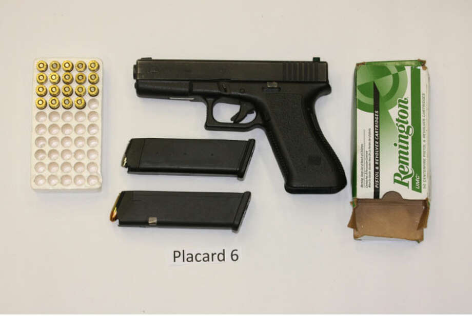 A pistol purportedly recovered from Mario Parra's backpack after a scuffle with police at the Sodo light rail station in Seattle. Parra's friend Oscar Perez-Giron was fatally shot by a King County deputy; police say Perez was also armed.