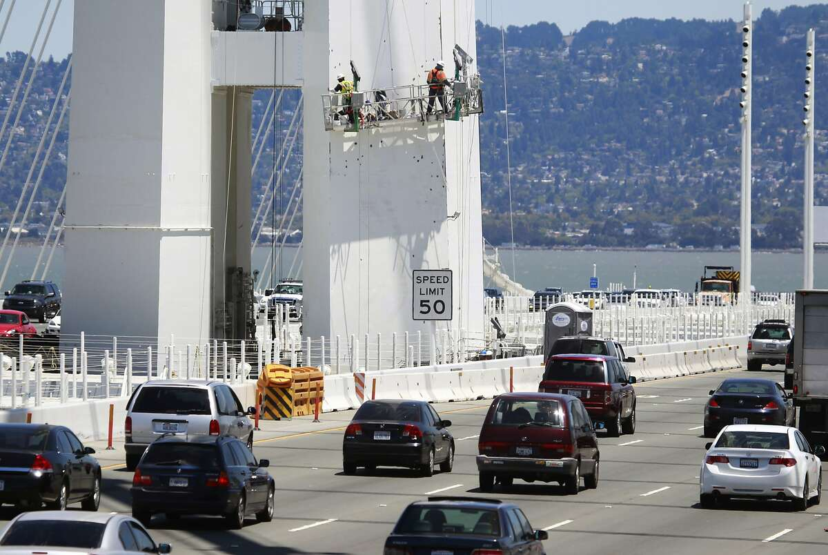 A bridge crew repaints the SAS tower of the new eastern Bay Bridge span in San Francisco, Calif. on Thursday, July 10, 2014.