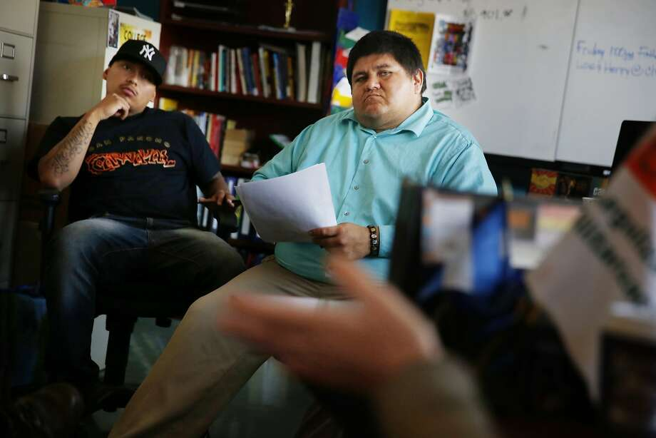 Victorino Cartagena (left) and Henry Morales work for  a San Francisco agency that helps young immigrants. Photo: Lea Suzuki, The Chronicle