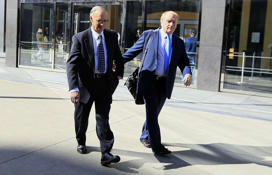 Robert Maegerle (left) leaves federal court in S.F. in 2012. He was convicted of economic espionage along with Walter Liew. Photo: Jeff Chiu, Associated Press