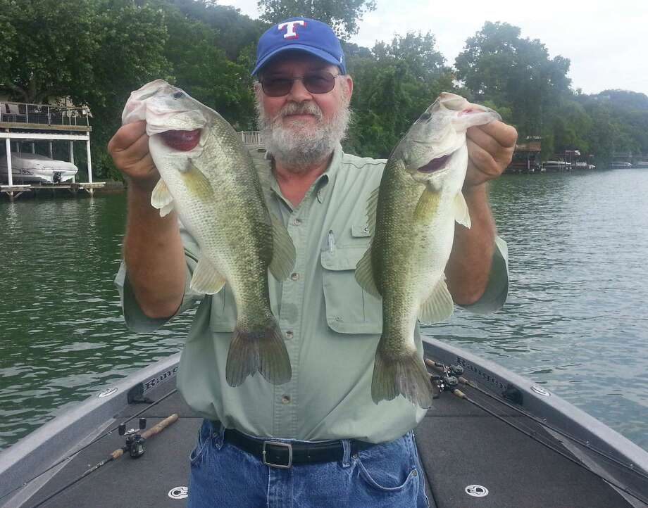 Ken Eilert holds a pair of black bass in the three-pound range caught at Lake Austin, where even bigger bass can be found. Photo: Courtesy Photos