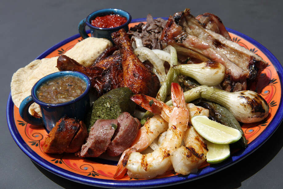 Parrillada for one to two with cecina (thinly sliced salted beef), pork ribs, chorizo, chicken and shrimp with macho sauce at El Machito on Jones Maltsberger Road near the Quarry. The restaurant specializes in mesquite-grilled meats, Northern Mexico-style. Photo: Photos By Cynthia Esparza / For The Express-News / For the San Antonio Express-News