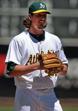 A's pitcher Jeff Samardzija was all smiles in his Oakland debut, allowing only one run and four hits over seven innings as the A's take the four-game series against the Toronto Blue Jays, winning 4-2 on Sunday, July 6, 2014 in Oakland, Calif.