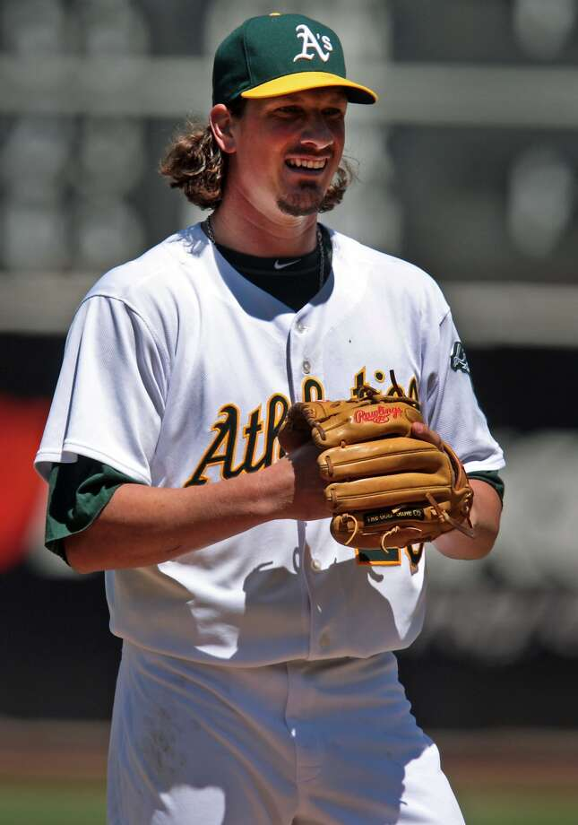 A's pitcher Jeff Samardzija was all smiles in his Oakland debut, allowing only one run and four hits over seven innings as the A's take the four-game series against the Toronto Blue Jays, winning 4-2 on Sunday, July 6, 2014 in Oakland, Calif. Photo: Kevin N. Hume, The Chronicle