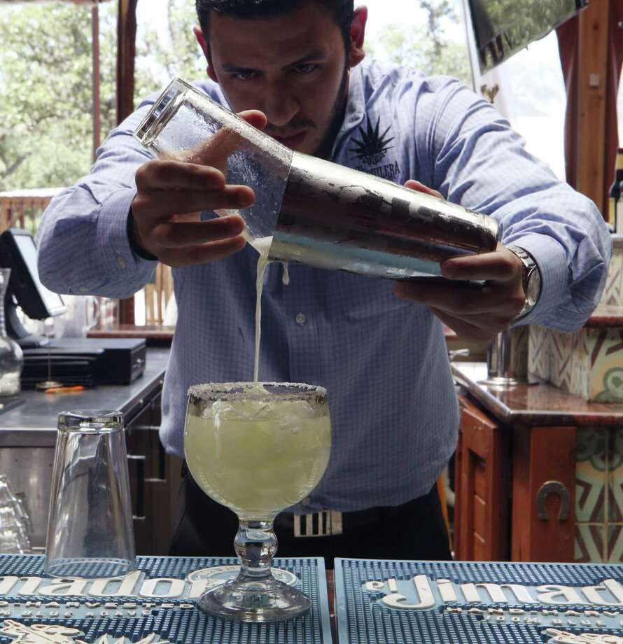 Fernando Echeverri mixes the Critics' Choice for Best Margarita at La Tequilera de Patrón, where he is general manager. Photo: Helen L. Montoya / San Antonio Express-News / SAN ANTONIO EXPRESS-NEWS
