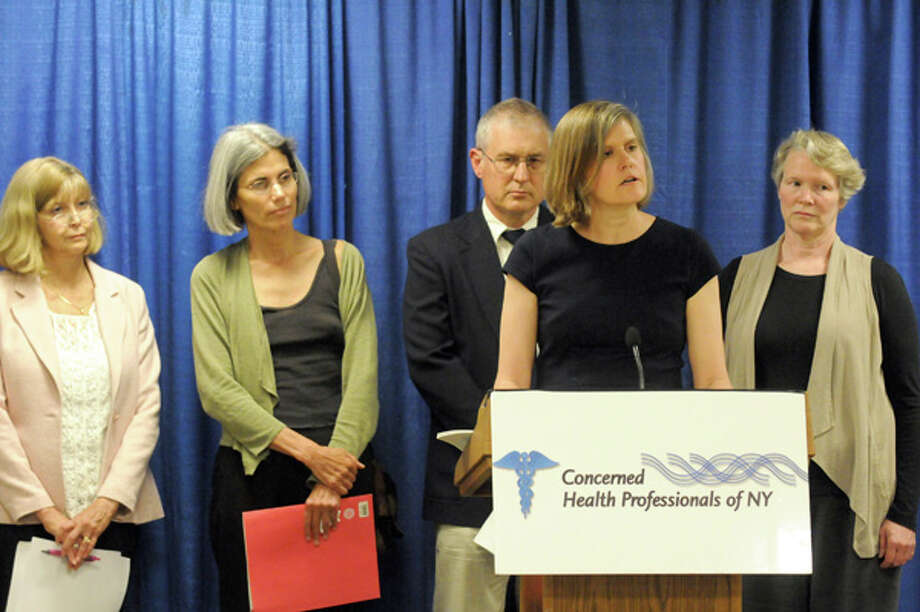 Sandra Steingraber, PhD, Distinguished Scholar in Residence at Ithaca College, at podium, with Concerned Health Professionals of New York speaks on fracking health issues during a Concerned Health Professionals of New York press conference Thursday, July 10, 2014, at the Legislative Office Building in Albany, N.Y. (Michael P. Farrell/Times Union) Photo: Michael P. Farrell, Albany Times Union / 00027739A