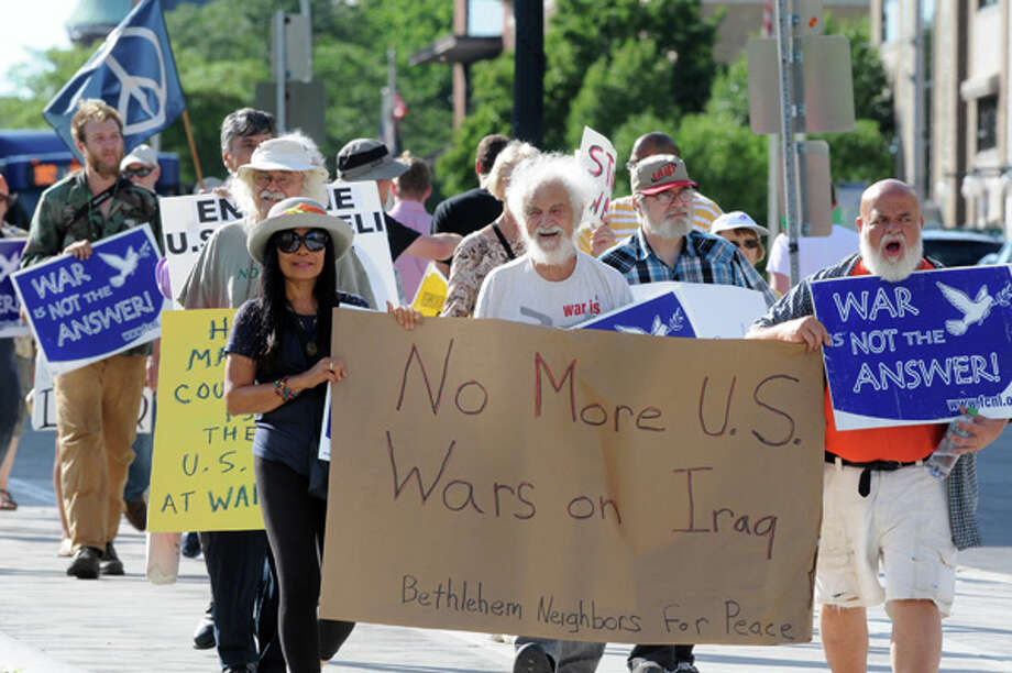 Local peace and anti-war activists march down Washington Avenue to let the Obama administration know that the they oppose any military action in Iraq on Thursday July 10, 2014 in Albany, N.Y. (Michael P. Farrell/Times Union) Photo: Michael P. Farrell, Albany Times Union / 00027718A
