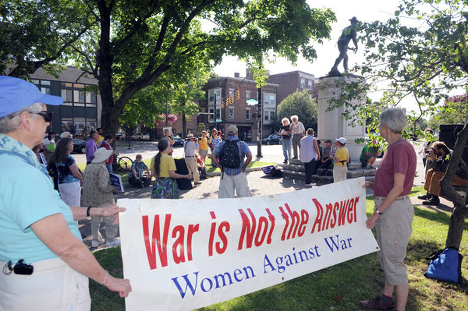 Local peace and anti-war activists gather at Townsend Park before marching to let the Obama administration know that the they oppose any military action in Iraq on Thursday July 10, 2014 in Albany, N.Y. (Michael P. Farrell/Times Union) Photo: Michael P. Farrell, Albany Times Union / 00027718A