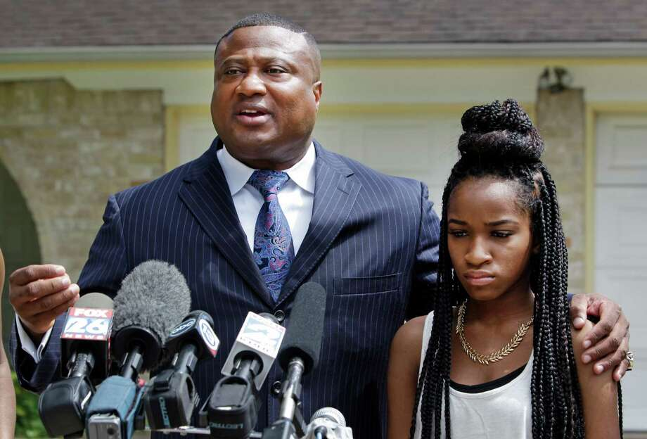 Standing outside a home near Stafford, Quanell X says a16-year-old girl identified only as Jada was raped after being given a spiked drink at a party there. Jada chose to share the allegations publicly.Quanell Xand the teen are demanding that police make an arrest in the case. Photo: Melissa Phillip, Houston Chronicle / © 2014  Houston Chronicle