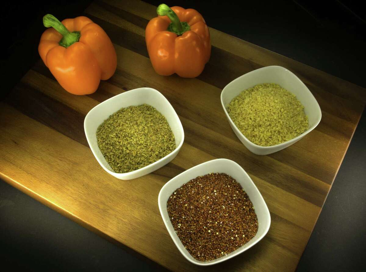 Freekeh, bulgur and red quinoa (clockwise from left) aren't staples in many Americans' diets but are versatile, filling and nutritious.