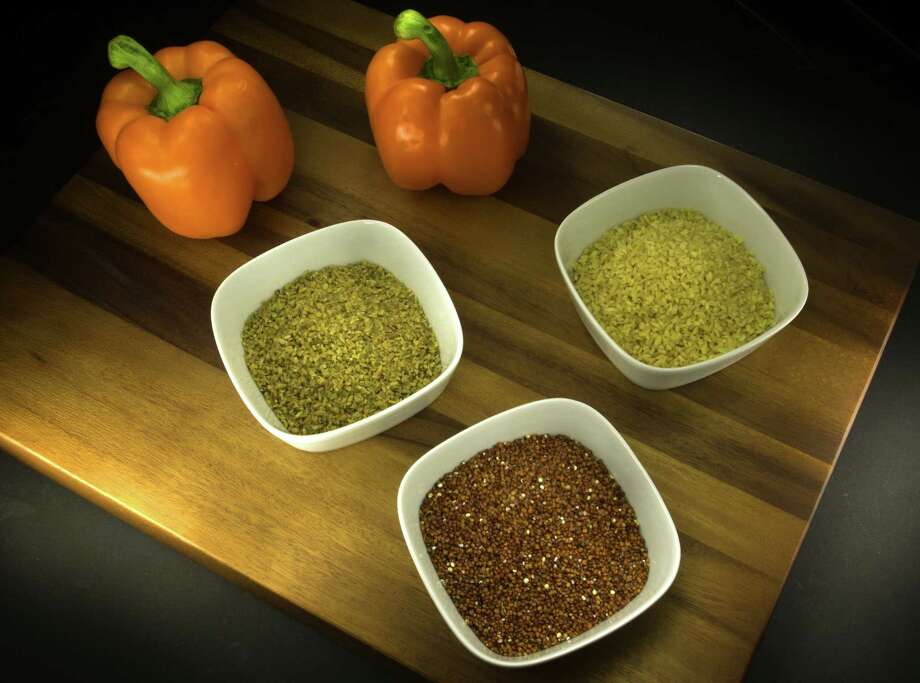Freekeh, bulgur and red quinoa (clockwise from left) aren't staples in many Americans' diets but are versatile, filling and nutritious. Photo: William Luther / San Antonio Express-News / © 2014 San Antonio Express-News