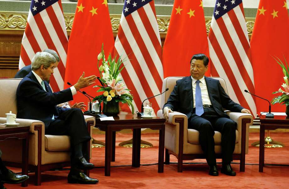 U.S. Secretary of State John Kerry meets with China's President Xi Jinping, right, at the Great Hall of the People in Beijing Thursday, July 10, 2014. (AP Photo/Jim Bourg, Pool) ORG XMIT: TOK322 Photo: Jim Bourg / Pool Reuters