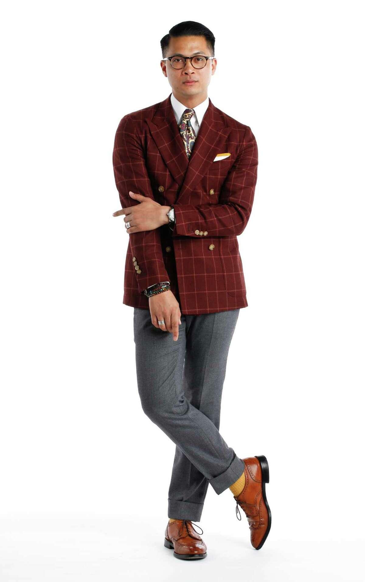 Beckett and Robb's Alan Maramag is seen wearing Beckett and Robb jacket, pants shirt, and pocket square, Alden shoes, and Ralph Lauren tie.