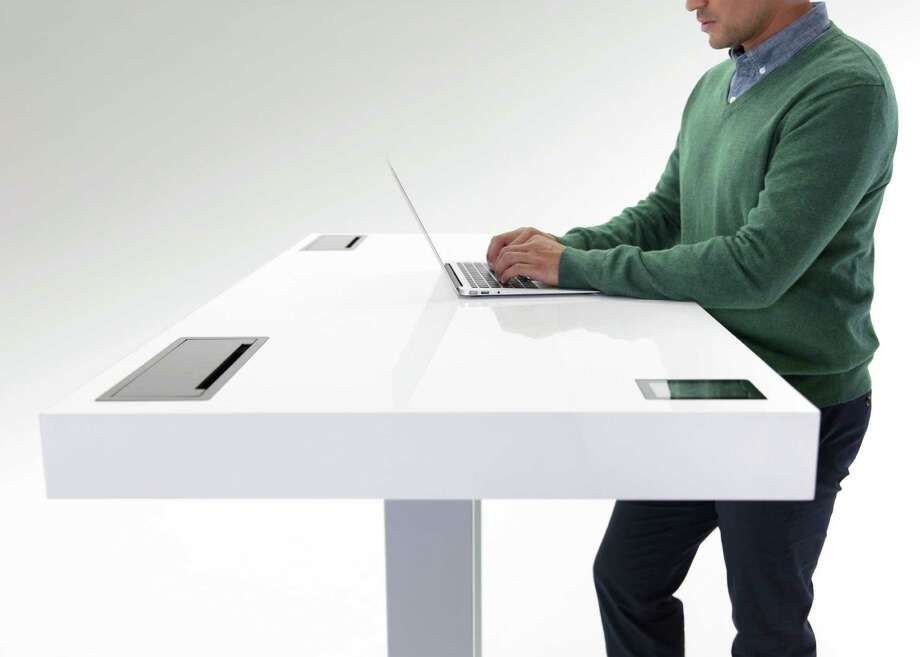 "David Pogue of Yahoo described the Stir Kinetic Desk as ""the Tesla of powered desks."" The desk senses when you arrive, prompts you to change positions, and tracks standing time and calories burned. Photo: Stir"