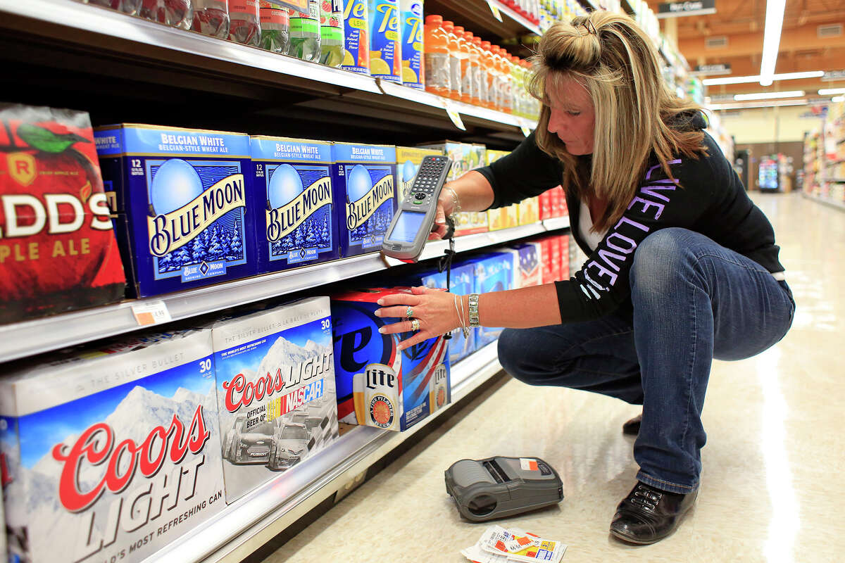 Peggi McHugh, Price Chopper scanning coordinator, scans barcodes as part of the setup team preparations for the grand opening of the new Watervilet Price Chopper Thursday, July 10, 2014, in Watervilet, N.Y. (Tom Brenner/ Special to the Times Union)