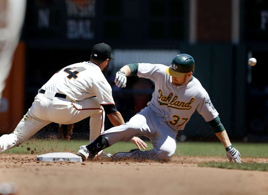 Brandon Moss slides into second with a double to start the sixth inning. Oakland had four extra-base hits in the inning, which ended with the A's leading 6-0. Photo: Brant Ward, San Francisco Chronicle