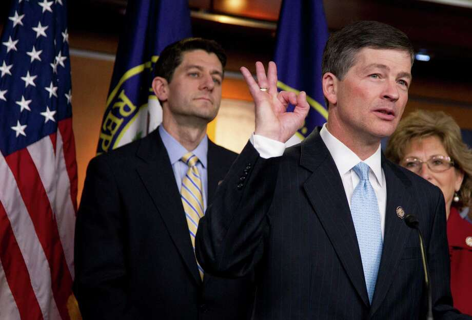 House Budget Chairman Rep. Paul Ryan, R-Wis. watches at left as  Republican Conference Chairman Rep. Jeb Hensarling, R-Texas gestures during a news conference on the GOP budget, on Capitol Hill in Washington Thursday, March 29, 2012. Photo: Manuel Balce Ceneta, STF / AP