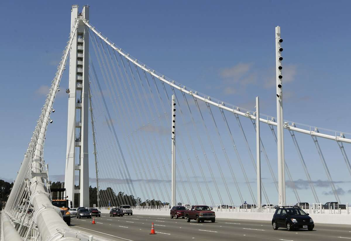 A bridge crew repaints the SAS tower of the new eastern Bay Bridge span from scaffolding in San Francisco, Calif. on Thursday, July 10, 2014.