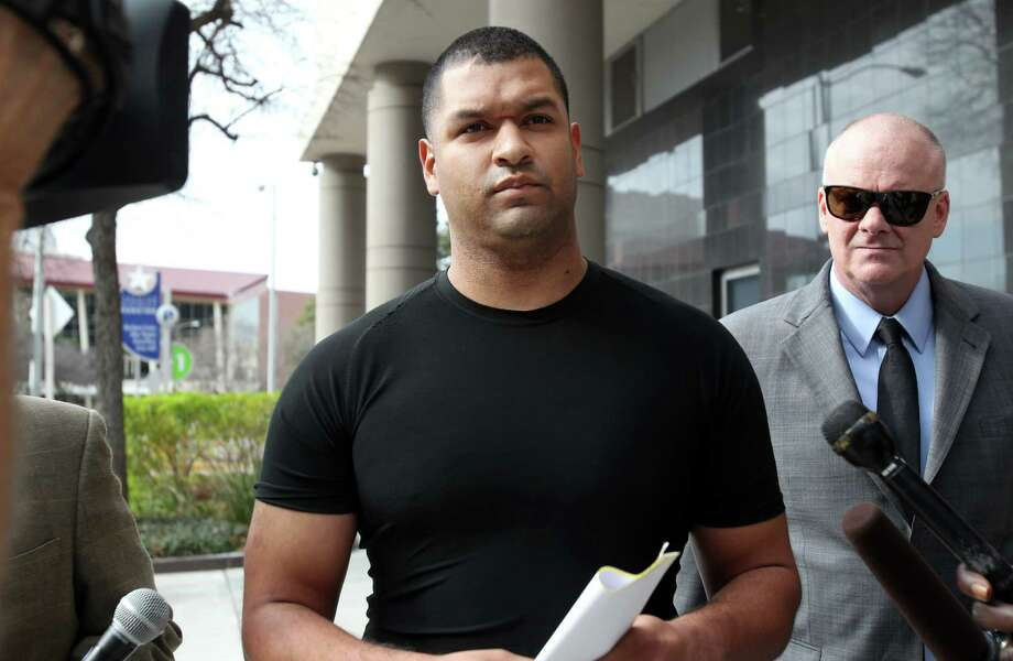 Emerson Canizales, 26, of Kingwood, walks out of the Bob Casey Federal Courthouse on Monday, Jan. 28, 2013, in Houston.  Houston Police Officer Canizales and fellow officer Michael Miceli, 26, of Humble,  were arrested on drug charges as they reported to work on Sunday. They were charged with conspiracy to violate teh Hobbs Act as well as conspiracy to possess a controlled substance. ( Mayra Beltran / Houston Chronicle ) Photo: Mayra Beltran, Staff / © 2013 Houston Chronicle