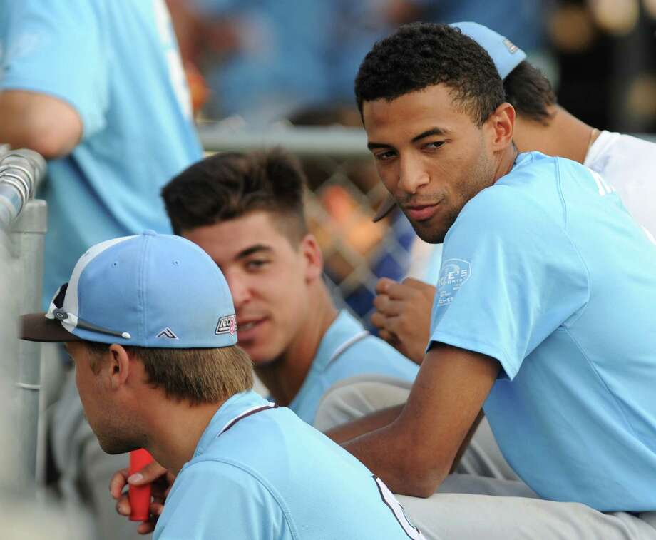 Mariano Rivera, Jr., son of former Yankee great Mariano Rivera, watches from the dugout during the Laconia Muskrats' NECBL baseball game against the Danbury Westerners at Rogers Park in Danbury, Conn. Thursday, July 10, 2014. Photo: Tyler Sizemore / The News-Times