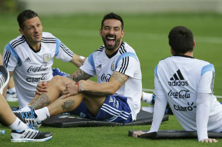 Martin Demichelis (from left) shares a laugh with teammates Ezequiel Lavezzi and Lionel Messi during a training session Thursday in Belo Horizonte, Brazil. Photo: Victor R. Caivano / Associated Press / AP