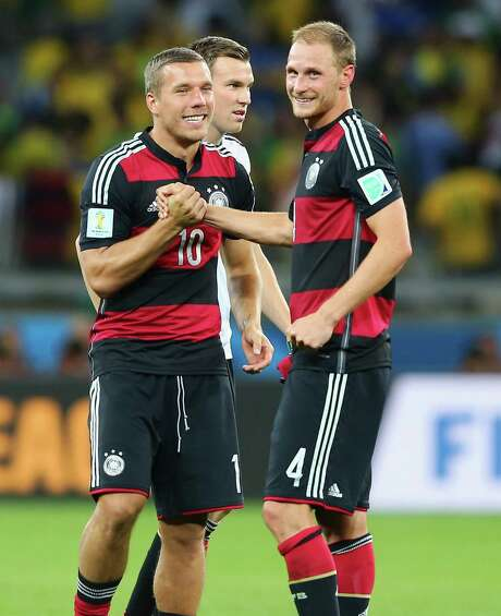 Benedikt Hoewedes (right), with teammate Lukas Podolski, has played every minute of the tournament. Photo: Martin Rose / Getty Images / 2014 Getty Images