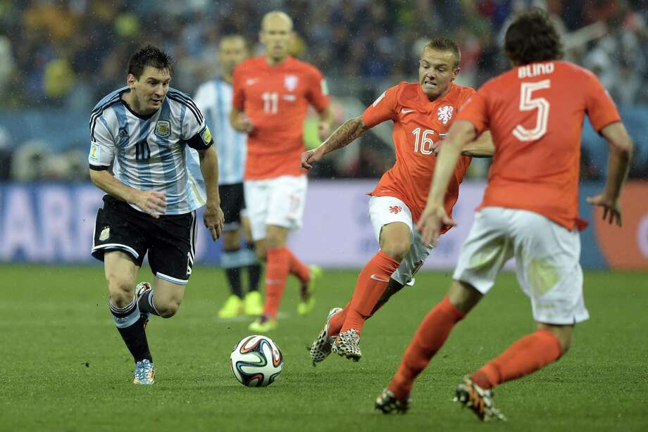 Argentina forward Lionel Messi, left, hasn't scored in three knockout-round matches, but Germany knows he is due because of his four goals in the group stage. Photo: JUAN MABROMATA, Staff / AFP